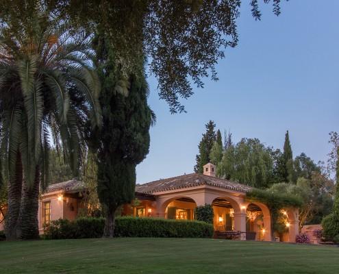 Spanish luxury cortijo at dusk rental Sotogrande