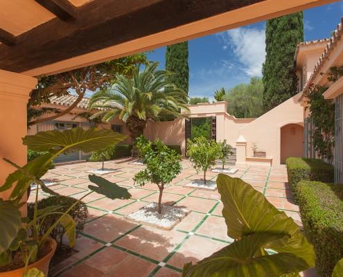 Luxury villa with orange tree courtyard patio
