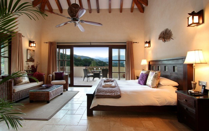 7 bed villa with indoor pool in el madronal luxury villa collection Master bedroom with sloped ceiling