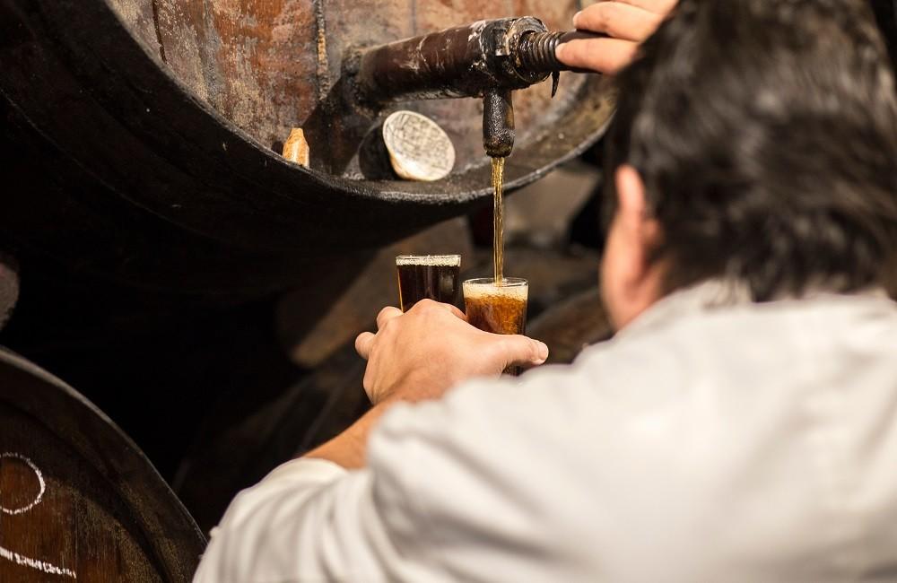 barman pouring malaga wine